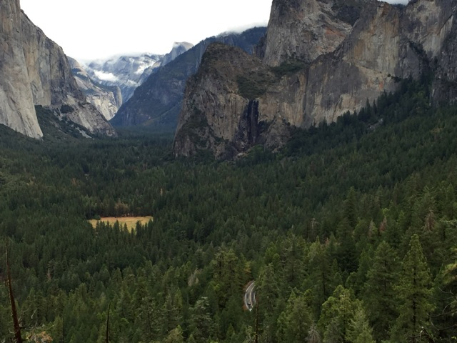 It's hard to see, but Half Dome and Bridalveil Fall are in the background.  The highway is far below in the trees.