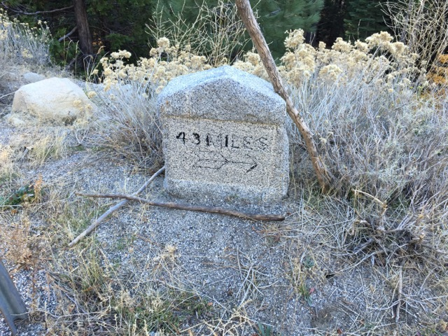 Old marker across the highway from the trail showing 43 miles to Placerville.